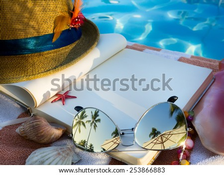 art Straw hat , book and Sunglasses on the beach - stock photo