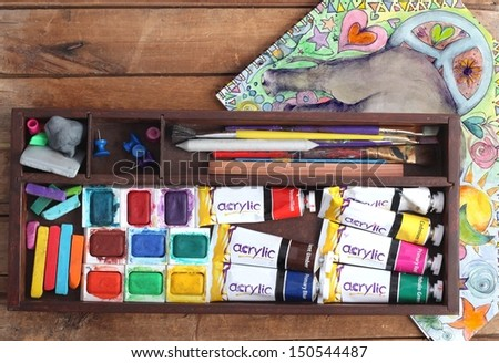 Art Supplies and Psychedelic Sketchbook - stock photo