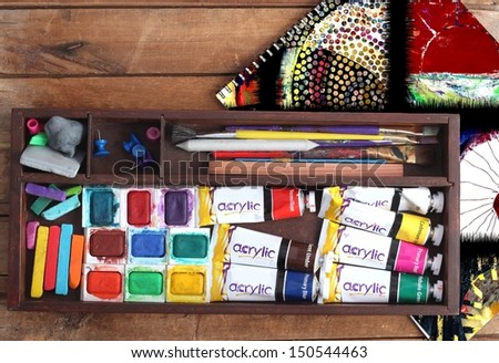 Art Supplies and Sketchbook with Abstract Painting - stock photo