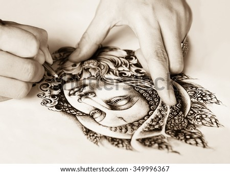 Art tattoo designs are hand drawn image of Buddha sepia color tone . As for the tattoo. Belief and faith in Buddhism. drawing white paper. - stock photo
