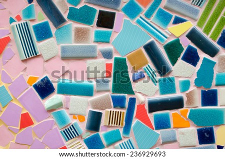 art tile wall made from crack tile, background made of ceramic tiles. - stock photo