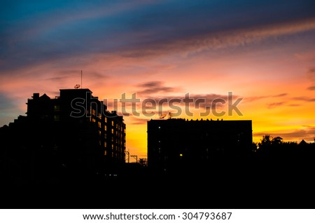 art tone,soft focus of building silhouette with sunset background - stock photo
