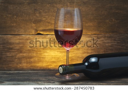 art wine glass on the wooden table - stock photo