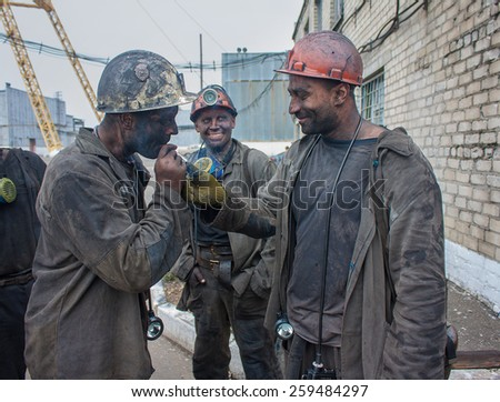 Artemivs'k, Ukraine - August, 06, 2013: Miners mine named Artem rise to the surface after the end of the work shift - stock photo