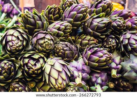 Artichokes on farmer market in Italy - stock photo