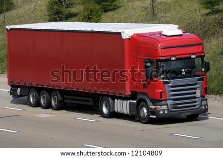 Articulated lorry and trailer traveling on UK motorway - stock photo