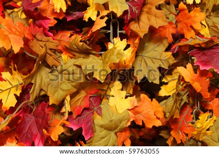 Artificial fall leafs background - stock photo