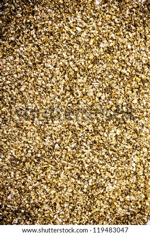 Artificial gold decoration background with sparkling - stock photo