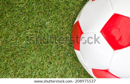 Artificial Grass with red football - stock photo