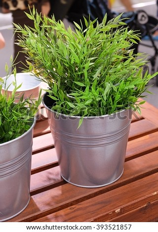 Artificial Green Plant or Artificial Plant in A Metal Pot for Home and Office Decoration without The Care. - stock photo
