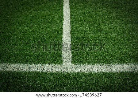 Artificial green turf texture background with white line marks - stock photo