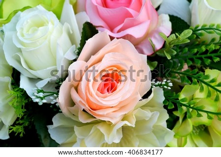 artificial orange, white, and pink roses bouquet close up from top view, roses flowers for wedding decoration - stock photo