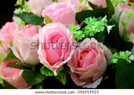 artificial pink orange rose bouquet, close up rose background - stock photo