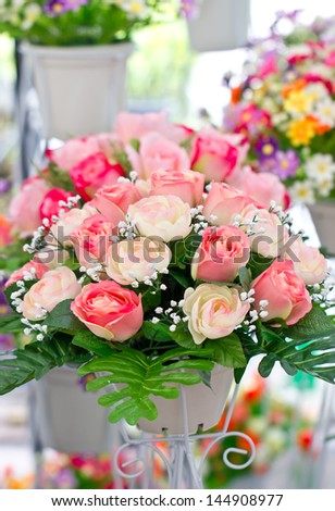 Artificial Roses in Pot. - stock photo