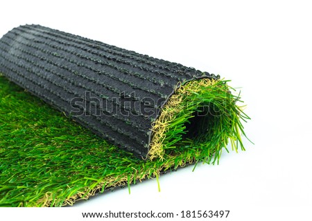 Artificial turf green grass roll on white background - stock photo