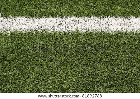 Artificial Turf of a Football Field Close up with copy space - stock photo