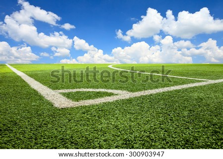 Artificial turf soccer field and blue sky - stock photo