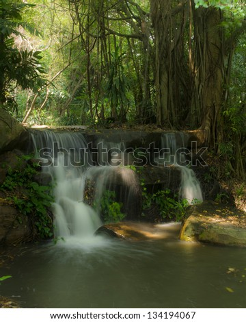 Artificial waterfall in park - stock photo