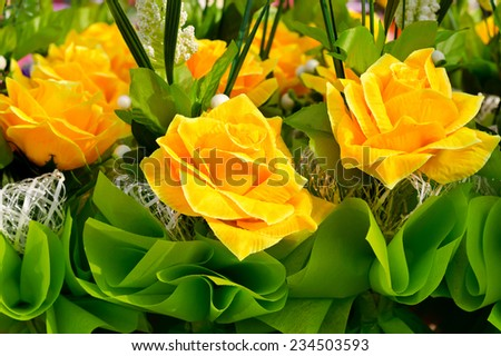 Artificial yellow rose bouquet - stock photo