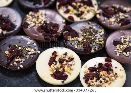 Artisan chocolate with cranberry and nuts, from above - stock photo