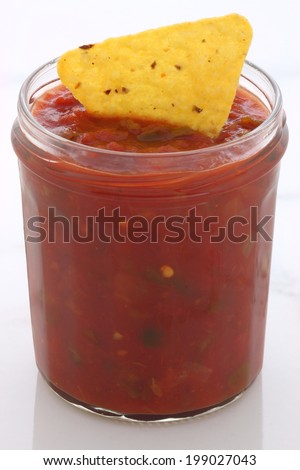 Artisan mexican dip salsa on vintage carrara marble table, with a delicious fresh mild hot flavor perfect for all your meals. - stock photo