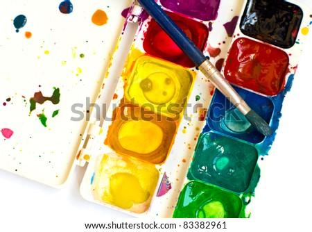 Artist brush and paint - stock photo