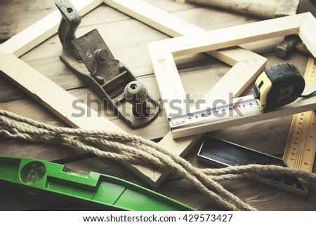Artist canvas, canvas stretcher and staple gun on table - stock photo
