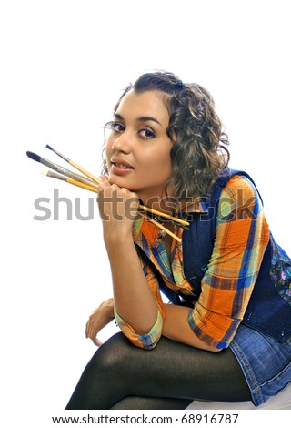 artist-girl with brushes - stock photo