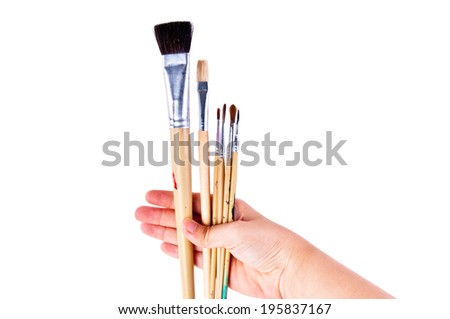 Artist Hand Holding Variety Mixed Size of Paintbrush Brush Ready to Paint in Art Work Concept and Idea isolated on white background. - stock photo