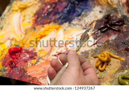 artist paints the sun - stock photo