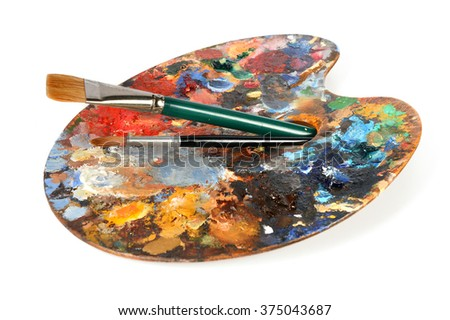 Artist palette with paintbrushes isolated over white background - stock photo