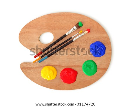 Artist's palette and brushes  isolated on white background - stock photo