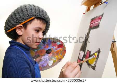 artist school boy painting brush watercolors portrait on a easel - stock photo