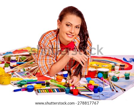 Artist smiling woman lying on paint palette. Isolated. - stock photo