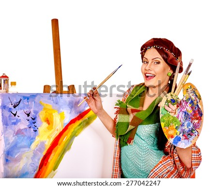 Artist woman at work at home. Isolated. - stock photo