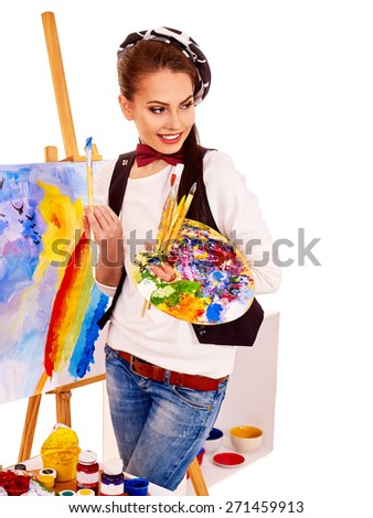 Artist woman at work. Isolated. Picture on easel. - stock photo