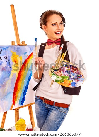 Artist woman at work near easel . Isolated. - stock photo