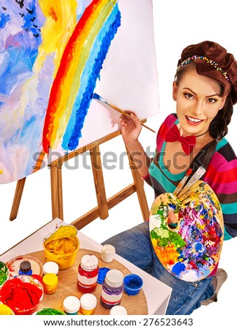 Artist woman painting on easel at work. Isolated. - stock photo