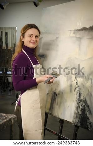 Artist working at the studio - stock photo