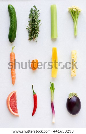 Artistic arrangement of fresh fruit and vegetables in colour gradient rainbow spectrum, interesting design food poster - stock photo