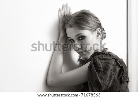 Artistic BW portrait of elegant young woman - stock photo