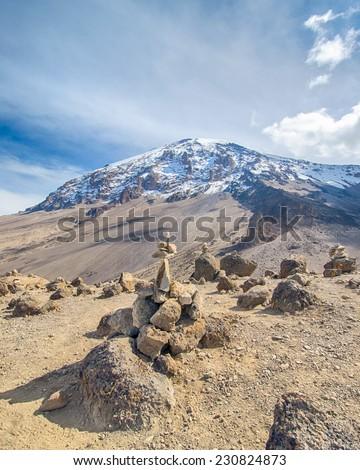 Artistic cairns point the way to Kibo, Machame-Mweka Route, Kilimanjaro National Park, near Arusha, Tanzania, Africa - stock photo