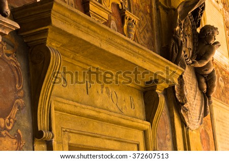 Artistic detail on old library building, city of Bologna, province Emilia-Romagna, Italy - stock photo