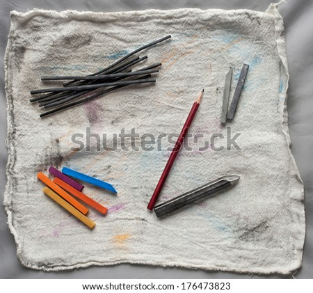Artistic drawing and sketching tools: graphite pencil, charcoal, chalk pastels on canvas support. - stock photo