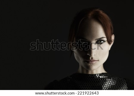 Artistic fashion portrait of young redhead woman. Shadow on half of face - stock photo