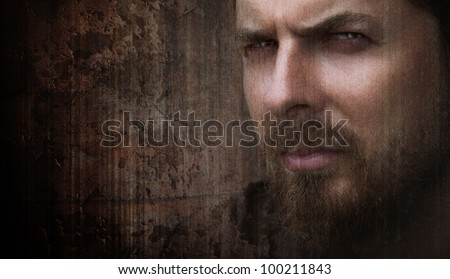 Artistic grungy portrait of cool man with nice eyes - stock photo