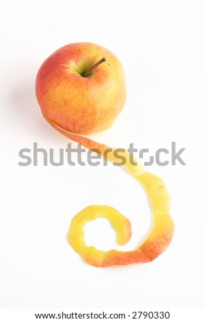 artistic peeled apple over white background - stock photo