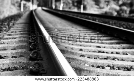 Artistic photo of rail, close up, railway fragment photo, abstract photo of railway in black and white, artistic, railway in black and white photo with blur background, dramatic, road end - stock photo