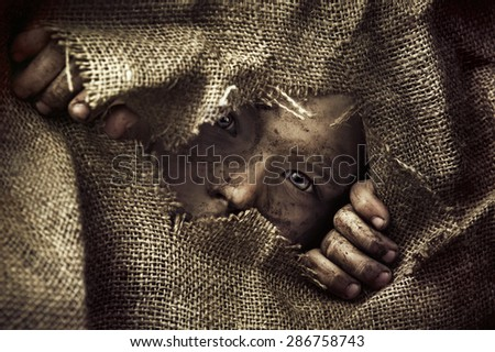 Artistic portrait of a poor little boy - stock photo