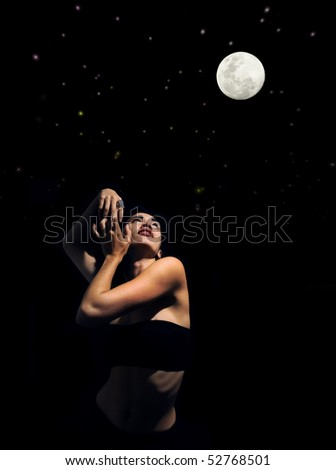 Artistic portrait of young woman posing under starry night with full moon - stock photo